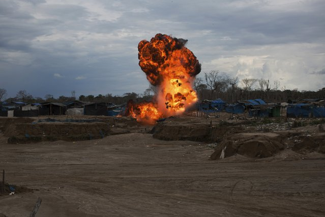 Peruvian police burn illegal miners' camps during an operation against illegal gold mining camps in La Pampa, in the southern Amazon region of Madre de Dios, Peru August 11, 2015. Picture taken August 11, 2015. (Photo by Sebastian Castaneda/Reuters)