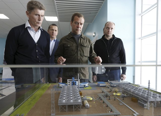 Russia's Prime Minister Dmitry Medvedev (C), acting Governor of Sakhalin region Oleg Kozhemyako (L) and Deputy Prime Minister and Presidential Plenipotentiary Envoy to the Far Eastern Federal District Yury Trutnev (2nd L) inspect the model of a local power plant during the visit to Iturup Island, one of four islands known as the Southern Kurils in Russia and the Northern Territories in Japan, August 22, 2015. (Photo by Reuters/RIA Novosti)