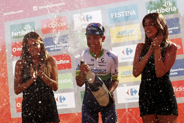 Orica GreenEdge rider Esteban Chaves of Colombia sprays champagne as he celebrates on the podium after winning the 158.7 km (98.6 miles) 2nd stage of the Vuelta Tour of Spain cycling race from Alhaurin de la Torre to Caminito del Rey, in Ardales, southern Spain, August 23, 2015. (Photo by Jon Nazca/Reuters)