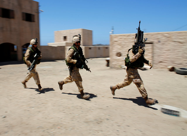 Canadian soldiers from the Royal 22nd Regiment run through a simulated village as they train during a non-combative extraction operation in urban terrain as part of Rim of the Pacific (RIMPAC) 2016 exercise held at Camp Pendleton, California United States, July 11, 2016. (Photo by Mike Blake/Reuters)