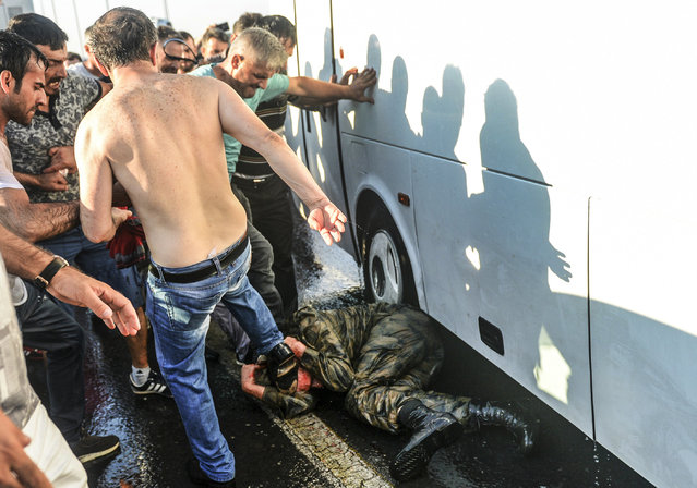 People kick and beat a Turkish soldier that participated in the attempted coup, on Istanbul's Bosporus Bridge, Saturday, July 16, 2016. Turkish President Recep Tayyip Erdogan told the nation Saturday that his government was working to crush a coup attempt after a night of explosions, air battles and gunfire across the capital that left dozens dead and scores wounded. Government officials said the coup appeared to have failed as Turks took to the streets overnight to confront troops attempting to take over the country. (Photo by Selcuk Samiloglu/AP Photo)
