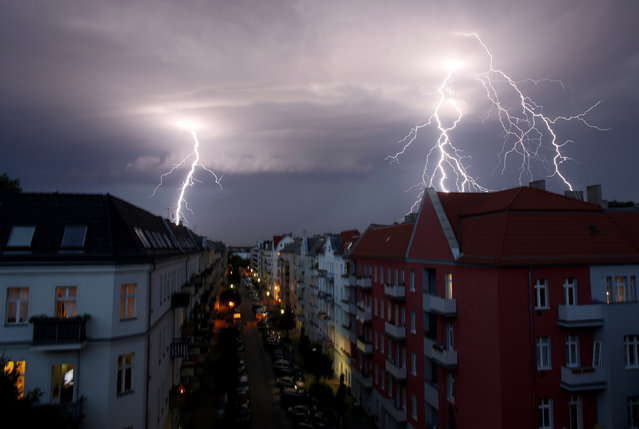 Lightnings strike over buildings during a thunderstorm in Berlin, June 29, 2012. (Photo by Pawel Kopczynski/Reuters)