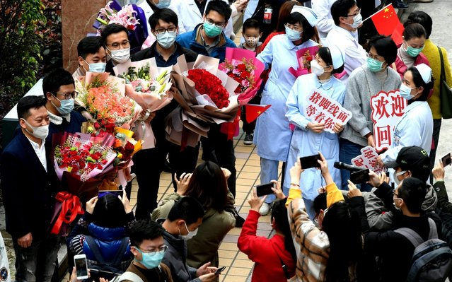 Members of the medical rescue team from Fujian are welcomed by their colleagues and families on April 6, 2020 in Fuzhou, Fujian Province of China. A total of 194 members of the first Fujian medical team finished their 14-day quarantine on Sunday after returning from Yichang of Wuhan province, the hardest-hit region of the coronavirus outbreak in China. (Photo by Wang Dongming/China News Service via Getty Images)