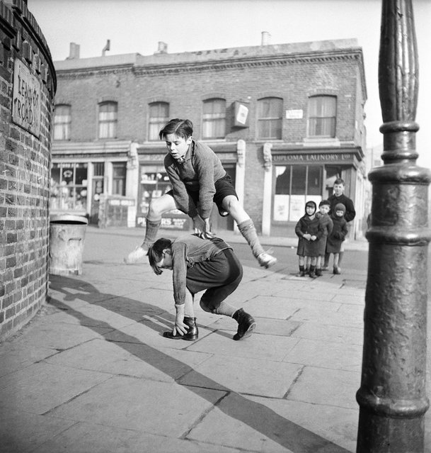 A group of children playing leap frog in the street, 1950.  (Photo by Bill Brandt)