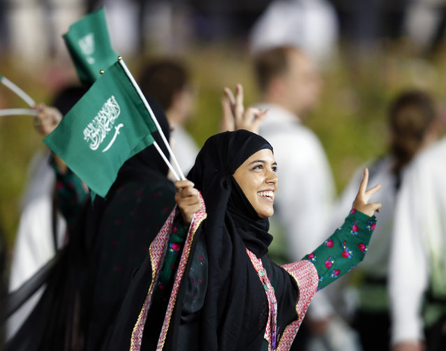 Women who are part of Saudi Arabia's first female Olympic athlete contingent take part in the athletes parade during the opening ceremony of the London 2012 Olympic Games, July 27, 2012. (Photo by Suzanne Plunkett/Reuters)