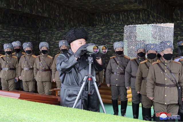 "In this Friday, February 28, 2020, file photo provided on Feb. 29, 2020 by the North Korean government, North Korean leader Kim Jong Un, center, inspects the military drill of units of the Korean People's Army, with soldiers shown wearing face masks. South Korea's military says North Korea has fired at least one unidentified projectile. The launch on Monday, March 2, 2020 came two days North Korea's state media said leader Kim supervised an artillery drill aimed at testing the combat readiness of units in front-line and eastern areas. Independent journalists were not given access to cover the event depicted in this image distributed by the North Korean government. The content of this image is as provided and cannot be independently verified. Korean language watermark on image as provided by source reads: ""KCNA"" which is the abbreviation for Korean Central News Agency. (Photo by Korean Central News Agency/Korea News Service via AP Photo/File)"