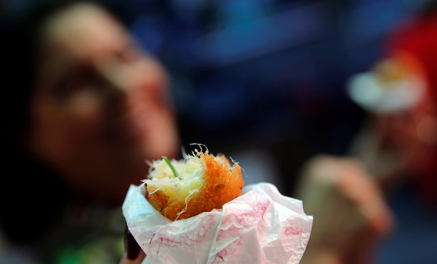 A view of traditional bolinhos de bacalhau (fried codfish balls) in Rio de Janeiro, Brazil, May 7, 2016. (Photo by Sergio Moraes/Reuters)