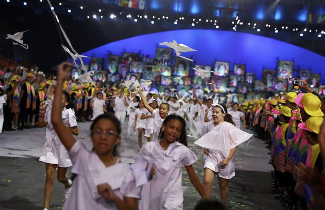 2016 Rio Olympics, Opening ceremony, Maracana, Rio de Janeiro, Brazil on August 5, 2016. Children run with kites in the shape of doves. (Photo by Kai Pfaffenbach/Reuters)