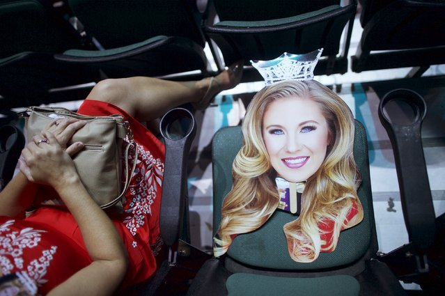 A paper cutout of Miss Mississippi Hannah Roberts rests on a seat before the first night of preliminaries of Miss America at Boardwalk Hall in Atlantic City, New Jersey, September 8, 2015. The 95th Miss America Pageant will be held September 13, 2015. (Photo by Mark Makela/Reuters)