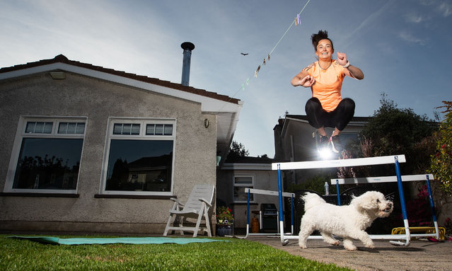 Irish athlete Ciara Neville exercises with her dog Minnie in Limerick, Ireland on May 19, 2020. (Photo by Tommy Dickson/INPHO/Rex Features/Shutterstock)