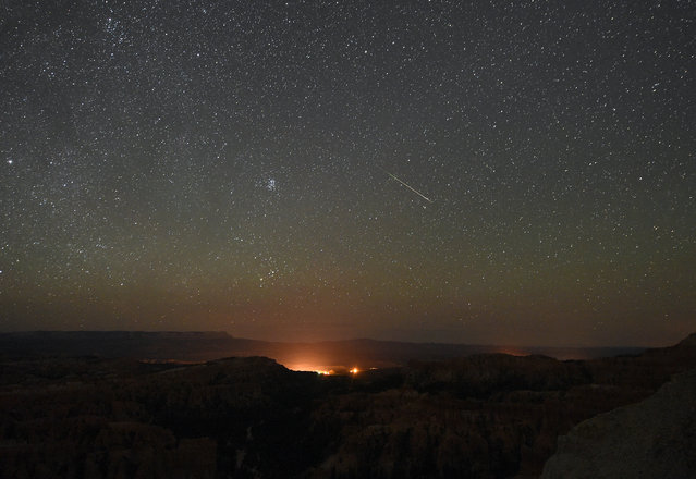 A Perseid meteor streaks across the sky above Inspiration Point early on August 12, 2016 in Bryce Canyon National Park, Utah. The annual display, known as the Perseid shower because the meteors appear to radiate from the constellation Perseus in the northeastern sky, is a result of Earth's orbit passing through debris from the comet Swift-Tuttle. (Photo by Ethan Miller/Getty Images)