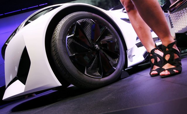 A model poses next to the Peugeot Fractal Concept during the media day at the Frankfurt Motor Show (IAA) in Frankfurt, Germany September 15, 2015. (Photo by Kai Pfaffenbach/Reuters)