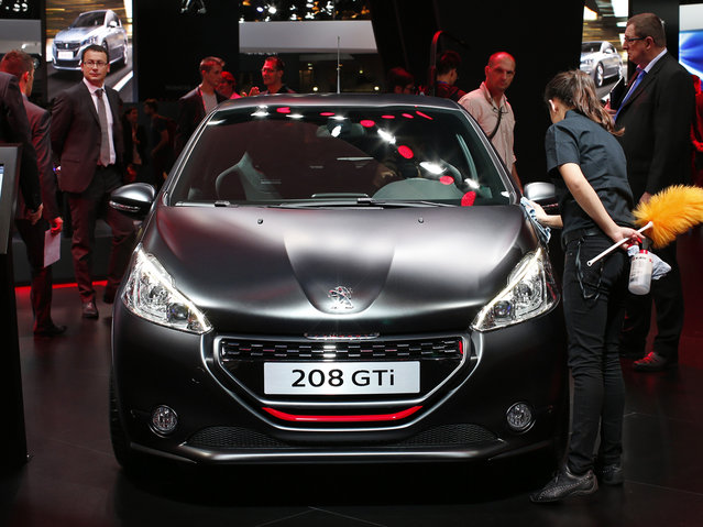 A new Peugeot 208 GTi car is displayed on media day at the Paris Auto Show on October 2, 2014. (Photo by Benoit Tessier/Reuters)