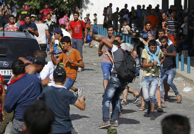 Syrian and Afghan migrants clash at the train station in Beli Manastir, Croatia September 18, 2015. Migrant numbers in Europe will build up in coming days and their flows may fragment further into new routes, the U.N. refugee agency said on Friday, urging the European Union to grasp a last chance to resolve the refugee crisis next week. (Photo by Laszlo Balogh/Reuters)