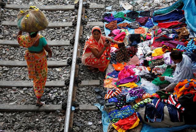A woman shops beside a railway track in Kolkata, India, November 17, 2017. (Photo by Rupak De Chowdhuri/Reuters)