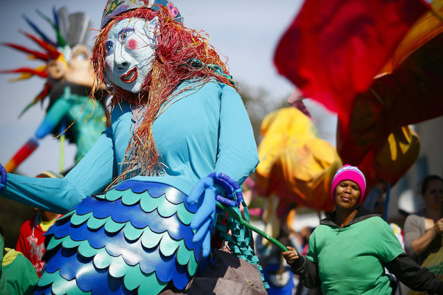 South Africans take part in the Mzantsi carnival parade during Heritage day public holiday in Cape Town, South Africa  24 September 2015. The Mzantsi carnival is an intercultural celebration of community building activities featuring a carnival parade around Ocean View. South African's across the country observe Heritage Day every year on 24 September where the counties diverse and colourful history is celebrated. (Photo by Nic Bothma/EPA)