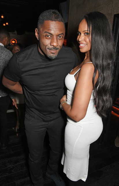 Idris Elba (L) and Sabrina Dhowre attend Idris Elba's Christmas Party at Kadie's Cocktail Bar & Club on December 9, 2017 in London, England. (Photo by David M. Benett/Dave Benett/Getty Images)