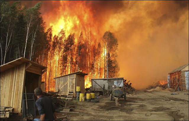 A 2015 file photo of a blaze near Lake Baikal, Russia. 2015 was the second-worst year on record for Russian wildfires and this year's blazes have begun unusually early. (Photo by The Siberian Time/Radio Free Europe/Radio Liberty)