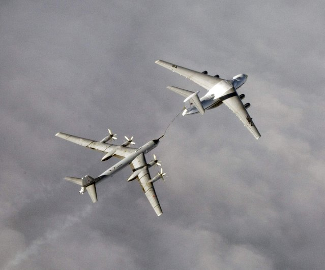 An undated handout photo provided by the Norwegian Army shows a Russian Tupolev Tu-95 strategic bomber refuelling over an unknown location during a military exercise. NATO aircraft tracked Russian strategic bombers over the Atlantic and Black Sea on October 29, 2014 and sorties of fighters over the Baltic in what the Western alliance called an unusual burst of activity at a tense time in East-West relations. (Photo by Reuters/Norwegian NATO QRA Bod)