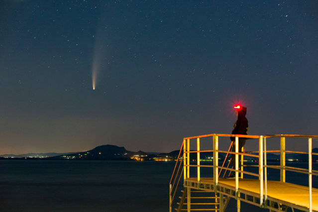 The Comet NEOWISE or C/2020 F3 is seen before sunrise over Balatonmariafurdo, Hungary, 14 July 2020. The comet passed closest to the Sun on 03 July and its closest approach to Earth will occur on 23 July. (Photo by György Varga/EPA/EFE)