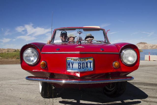 A 1964 Amphicar driven by James Spear of Henderson, Nevada is shown on the boat launch after a trip to Hoover Dam during the first Las Vegas Amphicar Swim-in at Lake Mead near Las Vegas, Nevada October 9, 2015. (Photo by Steve Marcus/Reuters)