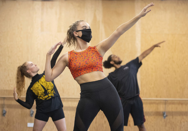 Students observe social distancing as they take part in a dance session as classes resume at Mountview Academy of Theatre Arts drama school following its closure due to coronavirus, in Peckham, south London, Tuesday, September 8, 2020. (Photo by Dominic Lipinski/PA Wire via AP Photo)