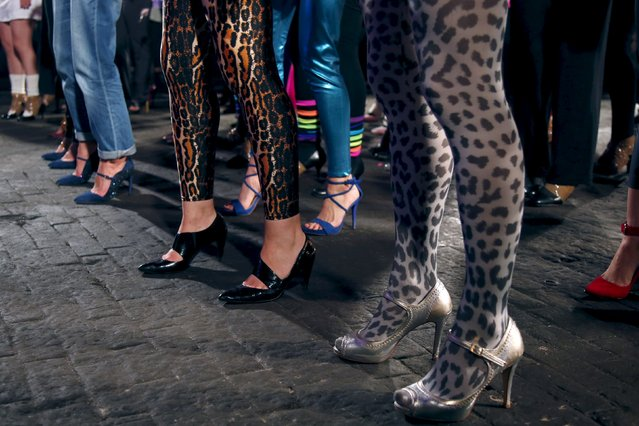 Contestants prepare to compete in a high heels race in Paris, France, October 15, 2015. (Photo by Charles Platiau/Reuters)