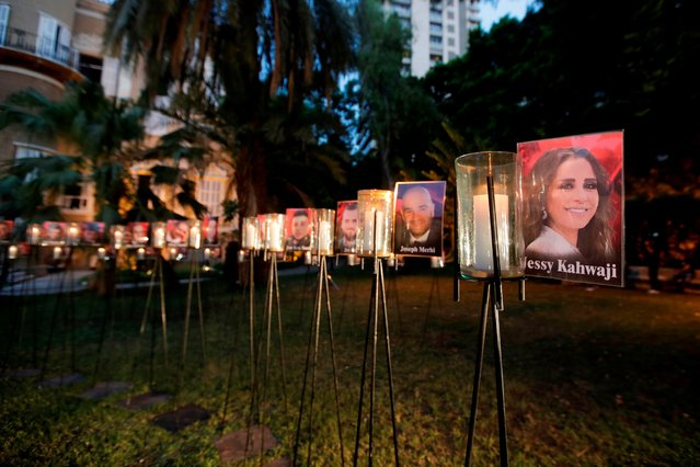 Candles light-up pictures of victims of August's deadly Beirut blast during a commemoration concert in the gardens of the damaged 19th-century Sursock Palace in Achrafieh in Lebanon's capital, on September 20, 2020. (Photo by Anwar Amro/AFP Photo)