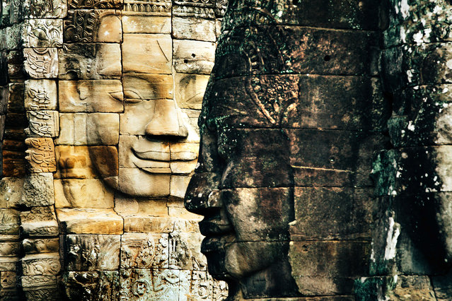 Bayon temple is known for its many  smiling faces. (Photo by Alex Teuscher/Caters News)