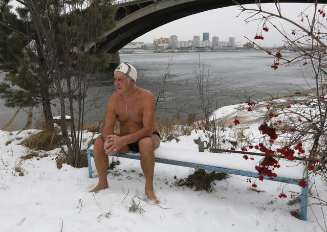 Ivan Abrosimov, 78, a member of a local winter swimmers' club, sits on a bench after bathing in Yenisei River in sub-zero temperatures in Russia's Siberian city of Krasnoyarsk, November 23, 2014. (Photo by Ilya Naymushin/Reuters)