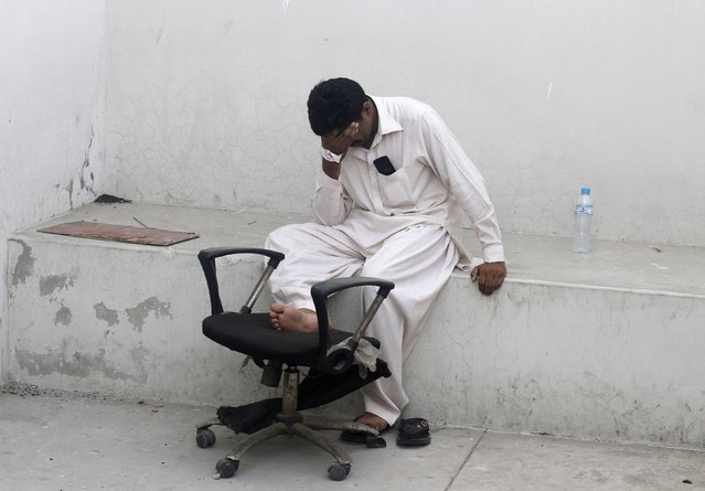 A man mourns the death of his relative, killed in Sunday's Taliban attack on Jinnah International Airport, outside a hospital morgue in Karachi, in this June 10, 2014 file photo. (Photo by Athar Hussain/Reuters)