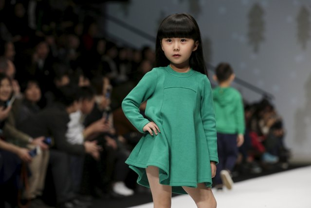 A model presents a creation from M.latin children's wear collection at China Fashion Week S/S 2016 in Beijing, China, October 28, 2015. (Photo by Jason Lee/Reuters)