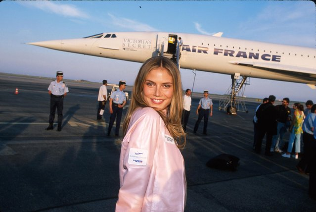 Model Heidi Klum in front of Concorde jet after arriving for Victoria's Secret fashion show at Cannes Film Festival on May 16, 2000. (Photo by Marion Curtis/DMI/The LIFE Picture Collection/Getty Images)