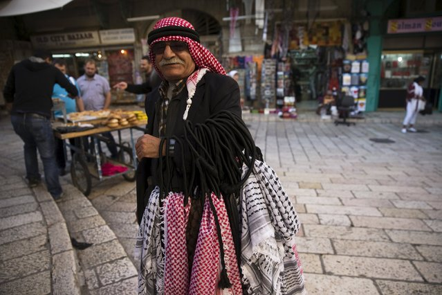 A Palestinian vendor stands near the Church of the Holy Sepulchre in Jerusalem's Old City October 29, 2015. A month ago, you couldn't get a table in Abu Shukri's hummus restaurant. Tucked in a backstreet of the Old City, off the Via Dolorosa, the place has long been regarded as the best hummus joint in the Holy Land. (Photo by Ronen Zvulun/Reuters)