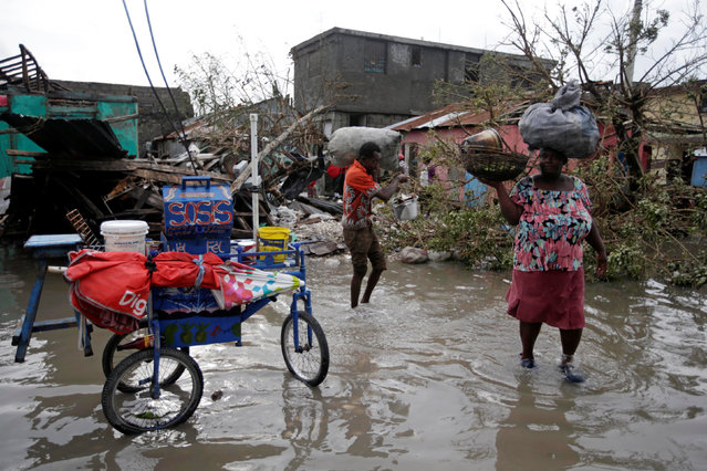 Residents walk in flooded area after Hurricane Matthew in Les Cayes, Haiti, October 5, 2016. (Photo by Andres Martinez Casares/Reuters)