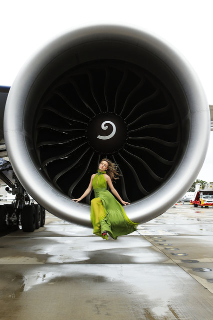Georgia May Jagger poses inside an engine of a British Airways 777 airliner in Sydney, Australia. Celebrating a new chapter in British Airways long history of flying between Australia and the UK, British Airways launched the new Boeing 777-300ER aircraft on the route with a special on board celebration. (Photo by Brendon Thorne)