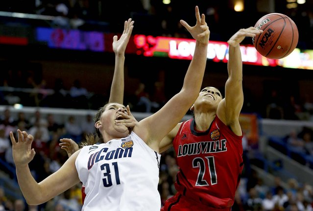 Louisville guard Bria Smith blocks a shot against Connecticut center Stefanie Dolson during the national championship game of the women's Final Four in New Orleans, on April 9, 2013. (Photo by Dave Martin/Associated Press)