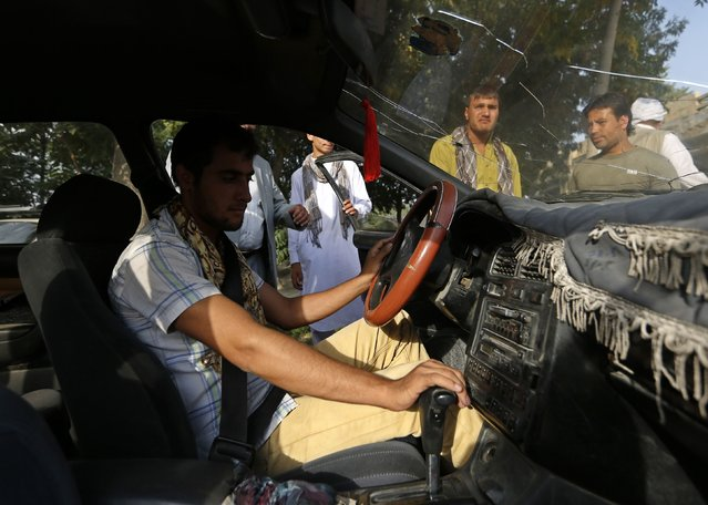 A student looks at a speedometer during a practical lesson at a driving school in Kabul August 24, 2014. (Photo by Mohammad Ismail/Reuters)