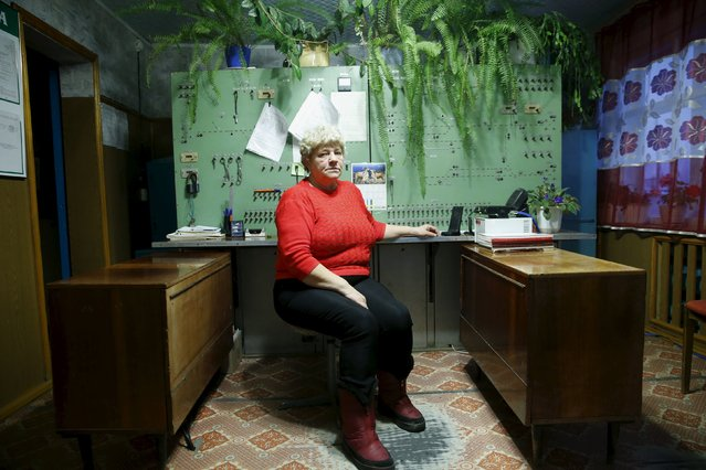 Nina Vysotina, 60, poses in her office at the railway depot in Elnichaya, in Sverdlovsk region, Russia October 16, 2015. Vysotina has worked for the railway for 42 years. (Photo by Maxim Zmeyev/Reuters)
