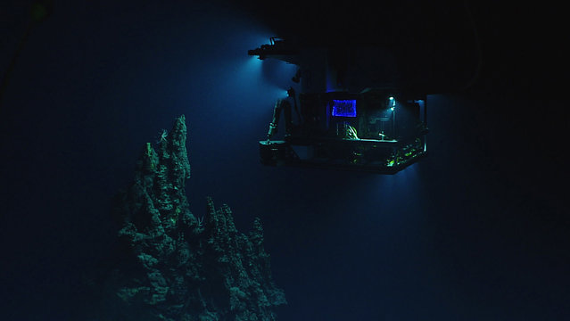 This April 28, 2016 image made available by NOAA shows the remotely operated vehicle Deep Discoverer surveying a 14-meter (46-foot) hydrothermal chimney during a deepwater exploration of the Marianas Trench Marine National Monument area in the Pacific Ocean near Guam and Saipan. Dives in the expedition ranged from 250 to 6,000 meters (820 feet to 3.7 miles) deep. (Photo by NOAA Office of Ocean Exploration and Research via AP Photo)
