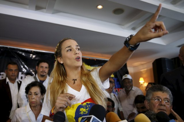 Lilian Tintori (C), wife of jailed opposition leader Leopoldo Lopez, speaks during a news conference in Caracas November 26, 2015. South America's regional bloc UNASUR and Venezuela's opposition called on Thursday for a probe into the murder of an activist days before a legislative election that has sparked fears of renewed political violence. Luis Diaz, a leader of the opposition Democratic Action party in Guarico state in Venezuela's central plains, was shot during a public meeting on Wednesday night, his movement said. (Photo by Carlos Garcia Rawlins/Reuters)