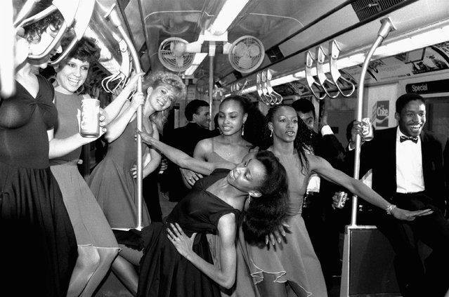 Members of the Apollo Rainbow Dancers stretch out in special A  train late on May 4, 1985, in New York. The legendary Apollo Theatre celebrated its 50th anniversary in an official reopening after a 15 month refurbishing with a celebrity studded evening. (Photo by Ray Stubblebine/AP Photo)