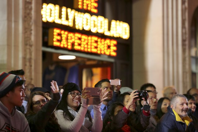 People on Hollywood Boulevard watch the 84th Annual Hollywood Christmas Parade in the Hollywood section of Los Angeles, California, November 29, 2015. (Photo by David McNew/Reuters)
