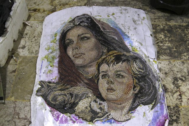 A mosaic artwork, copied from an original painting, is pictured in a workshop in Kafranbel town in the Idlib governorate January 17, 2015. The mosaic workshop with 30 workers, manufactures artistic and revolutionary mosaics in Kafranbel. Each mosaic artwork takes 5 to 10 days to complete. (Photo by Khalil Ashawi/Reuters)
