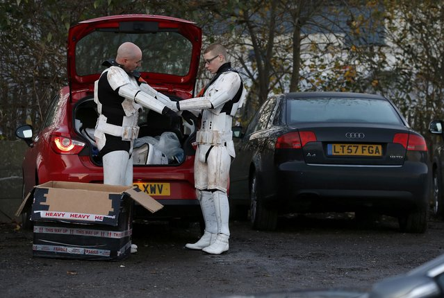 Men put on storm trooper costumes in the car park as they arrive  'For The Love of The Force' Star Wars fan convention in Manchester, northern England, December 4, 2015. (Photo by Phil Noble/Reuters)