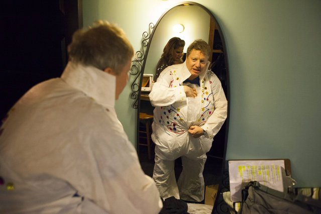 A participant prepares backstage during the 20th annual Seattle Invitationals, an amateur Elvis impersonator competition, in Seattle, Washington January 23, 2015. (Photo by David Ryder/Reuters)