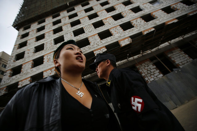 Ariunbold and Uranjargal (L), leaders of the Mongolian neo-Nazi group Tsagaan Khass, stand next to a construction site in Ulan Bator June 22, 2013. (Photo by Carlos Barria/Reuters)