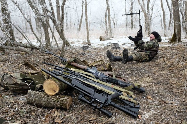 A student from the General Yermolov Cadet School sits near educational weapons during a field exercise outside the south Russian city of Stavropol January 25, 2015. (Photo by Eduard Korniyenko/Reuters)