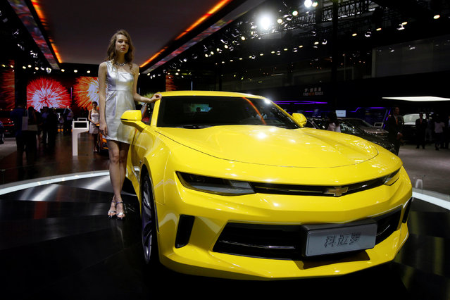 A model poses beside a Camaro by Chevrolet during China (Guangzhou) International Automobile Exhibition in Guangzhou, China November 18, 2016. (Photo by Bobby Yip/Reuters)