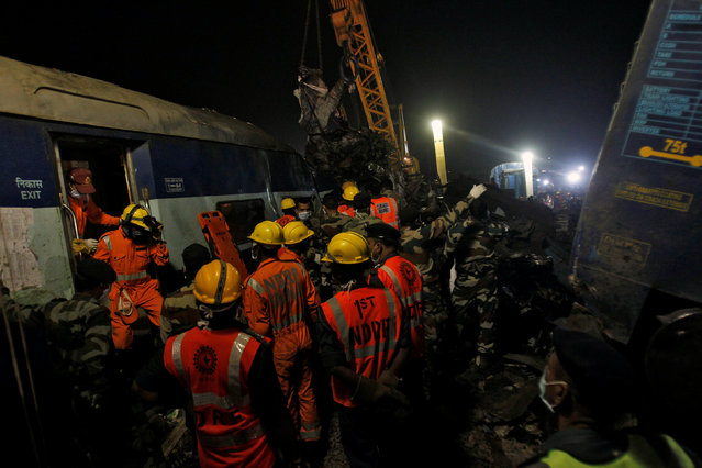 Rescue workers search for survivors at the site of a train derailment in Pukhrayan, south of Kanpur city, India November 20, 2016. (Photo by Jitendra Prakash/Reuters)